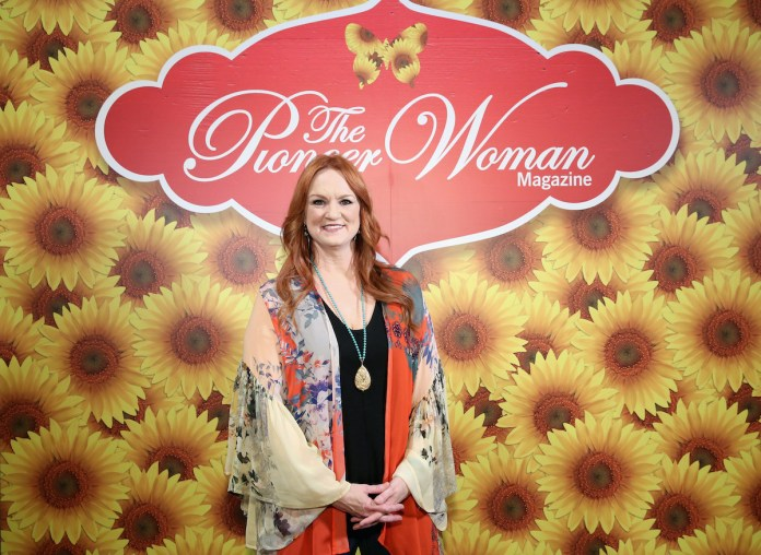 Ree Drummond poses with folded hands at The Pioneer Woman magazine event