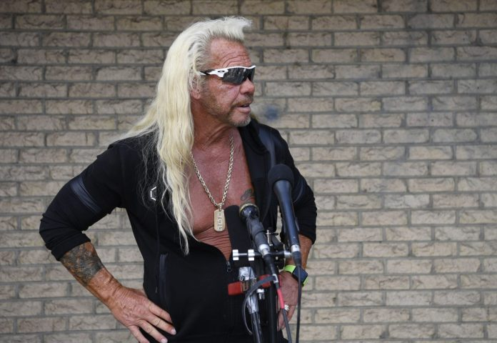 Doug the Bounty Hunter answers questions at a press conference in August 2019