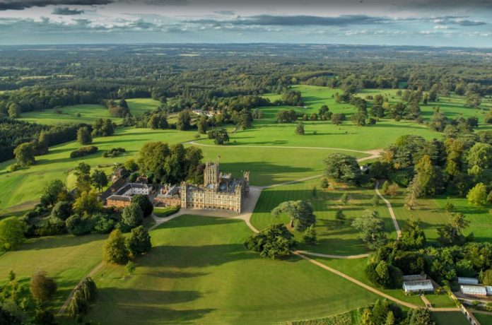 An aerial photo of Highclere Castle in Hampshire, England serving as the set of 'Downton Abbey'