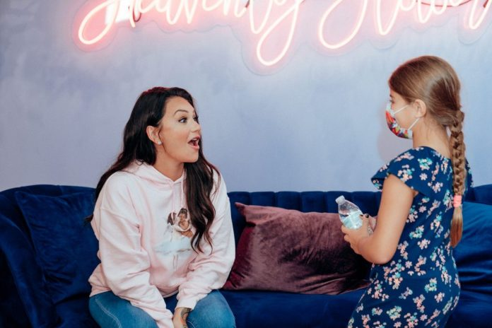 Jenny 'JWoww' Farley chats with a young fan at her Heavenly Flower Store event on September 22, 2021