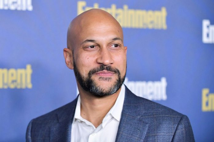 Keegan-Michael Key, in a blue jacket and white shirt, at the Entertainment Weekly pre-SAG event in 2020.