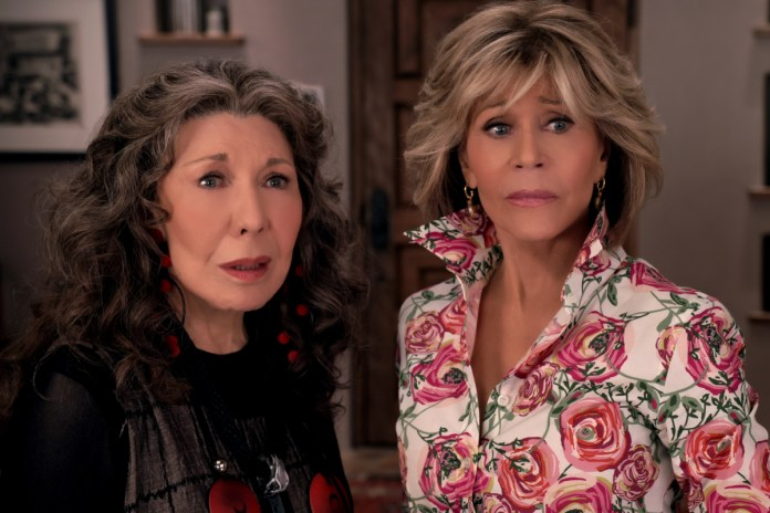 Grace Hanson and Frankie Bergstein look at the camera in surprise.