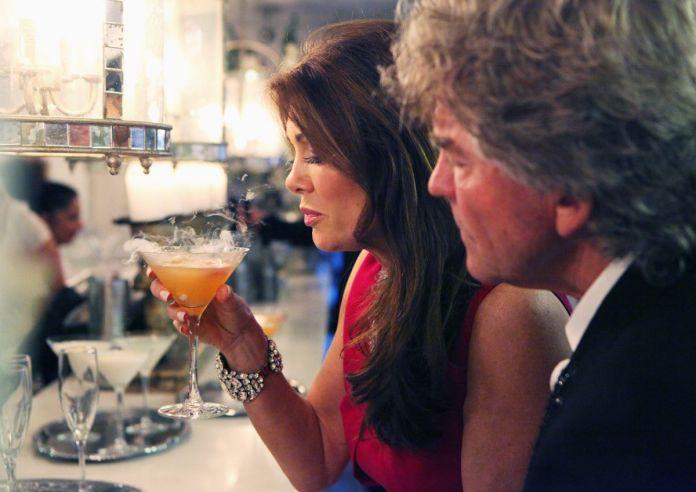 Lisa Vanderpump with a drink and her husband, Ken Todd.