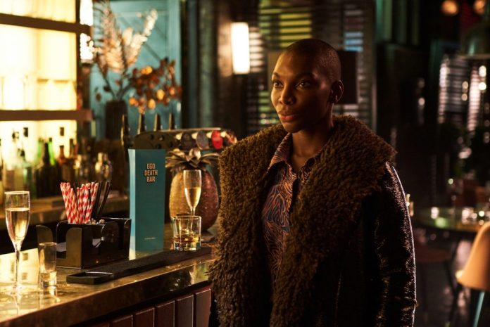 Michaela Coyle standing next to a bar in 'I May Destroy You'.