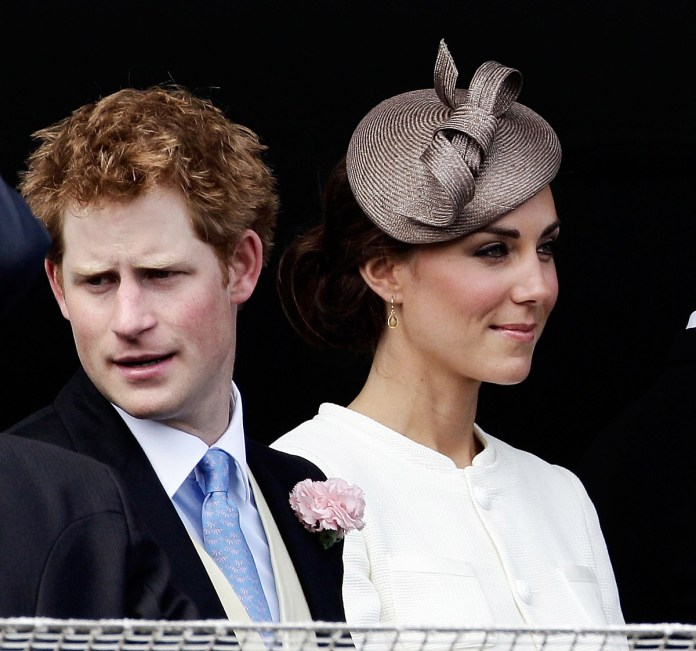 Prince Harry and Kate Middleton look forward to the start of the Epsom Derby in 2011