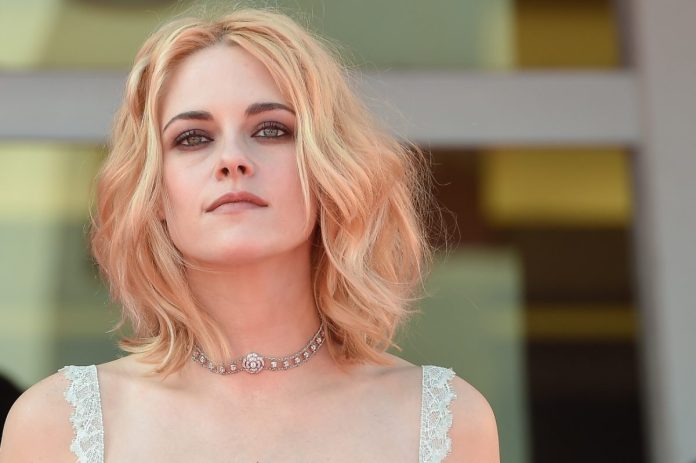 Kristen Stewart posing on the red carpet at the premiere of 'Spencer'