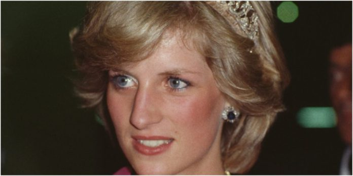 Princess Diana is wearing a blush colored gown and crown.