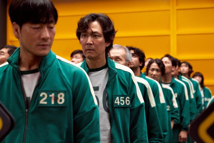 The cast of 'Squid Game' lining up in their track suits