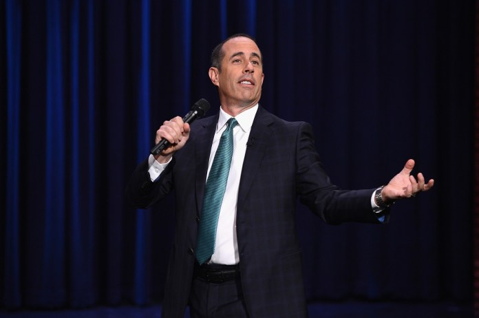 Jerry Seinfeld, 'Be Movie' star and casual cultural influencer, wearing a suit during a standup set for The Tonight Show