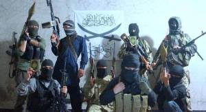 Fighters of Jamaat Ahadun Ahad posing with rifles and Qu'rans|Photograph released by the group on August 10th.