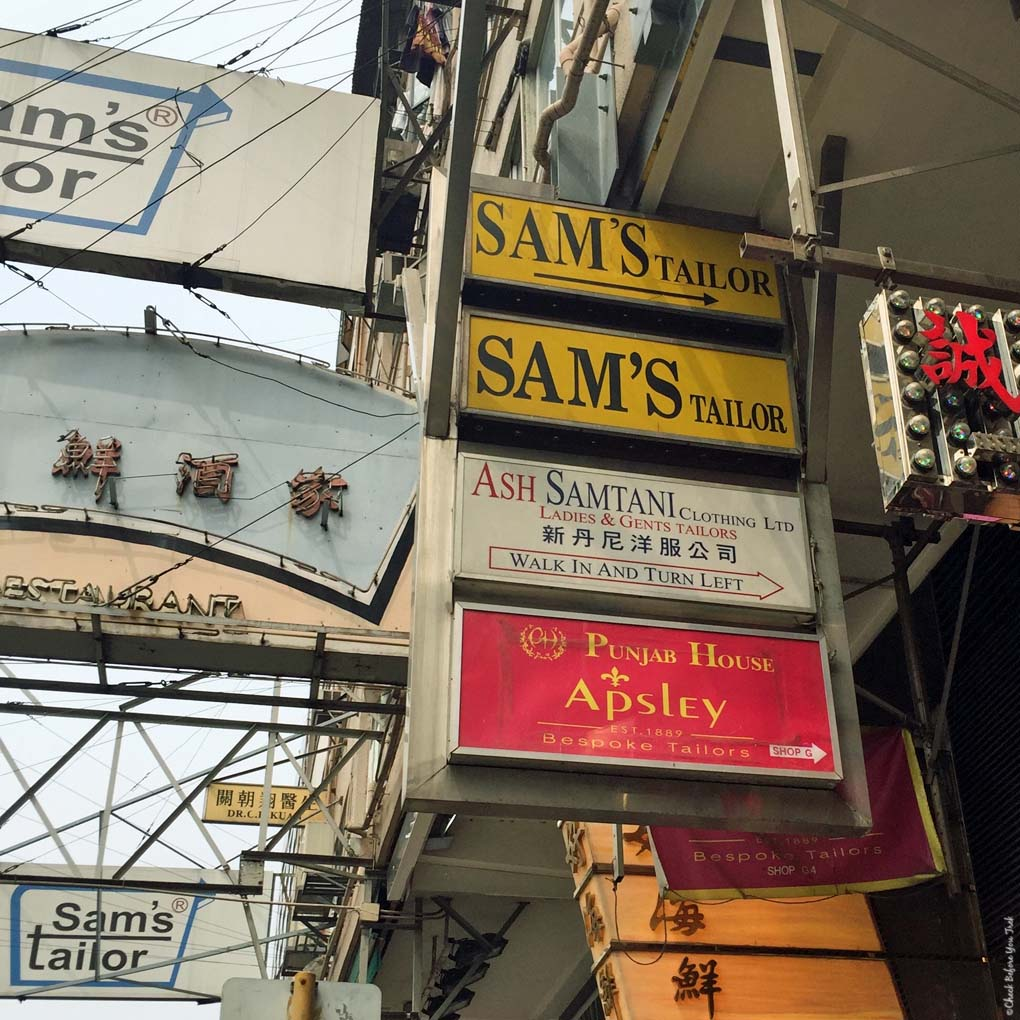 Signs on Nathan Road directing you to Sam's Tailor - Tsim Sha Tsui, Hong Kong, China