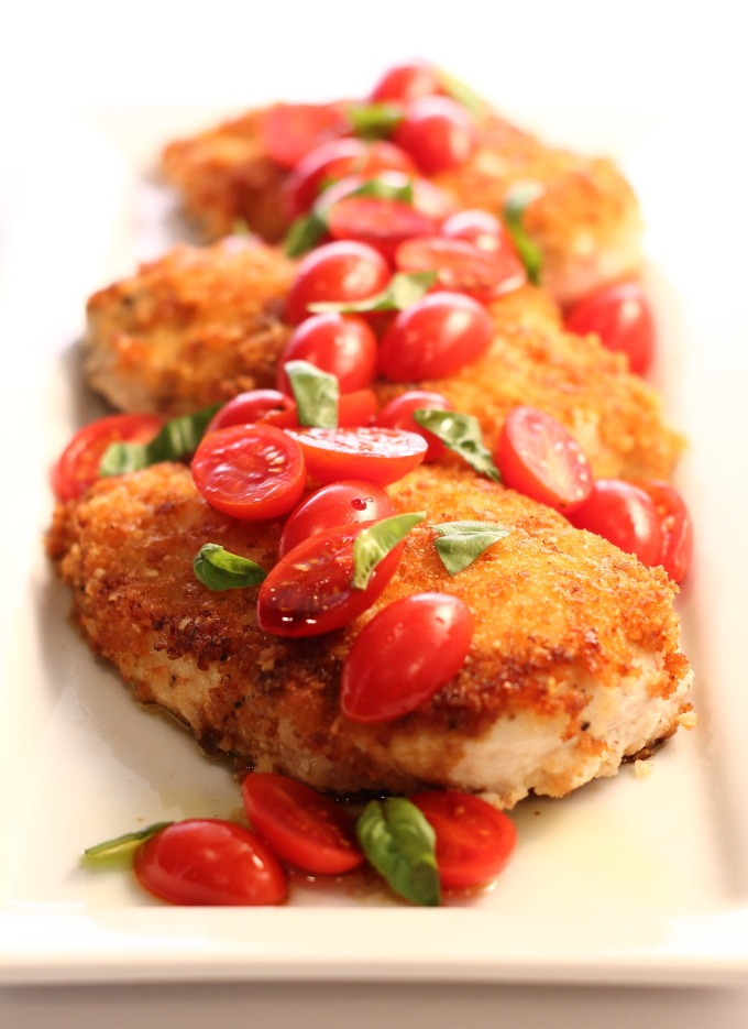 Crispy, savory chicken that dresses up with tomatoes, aged balsamic and fresh basil for a fast and fresh dinner and makes great chicken tenders for the kids. I love dinners that do double duty.