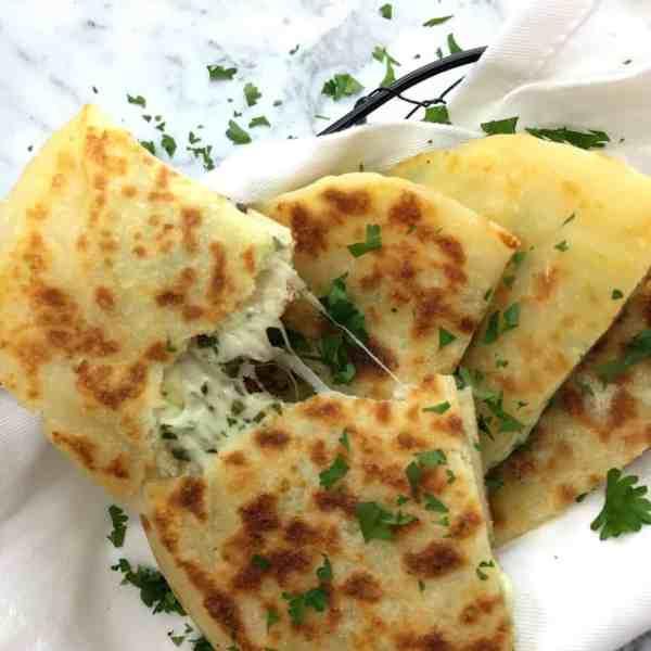 Cheesy Garlic Flatbread - cheese, herbs and garlic stuffed into a super easy flatbread