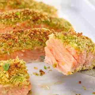 close up of cut slice of cooked salmon with crumb topping