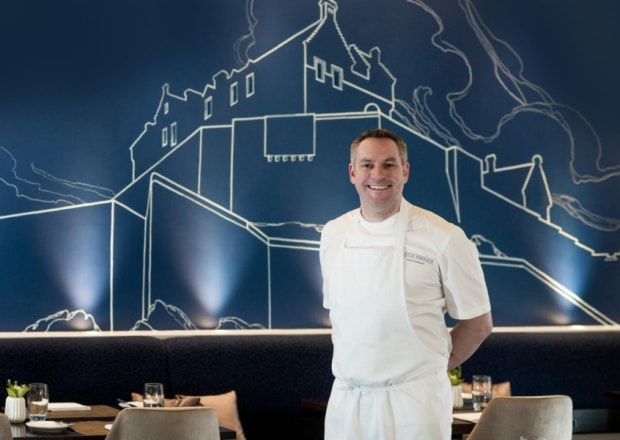 Dominic Jack with his restaurant's new mural. Picture: Contributed