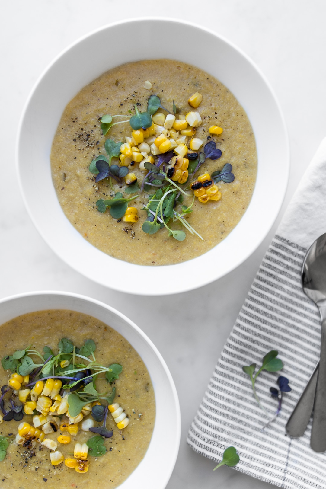 Coconut Corn Chowder with Micro Greens and Charred Corn