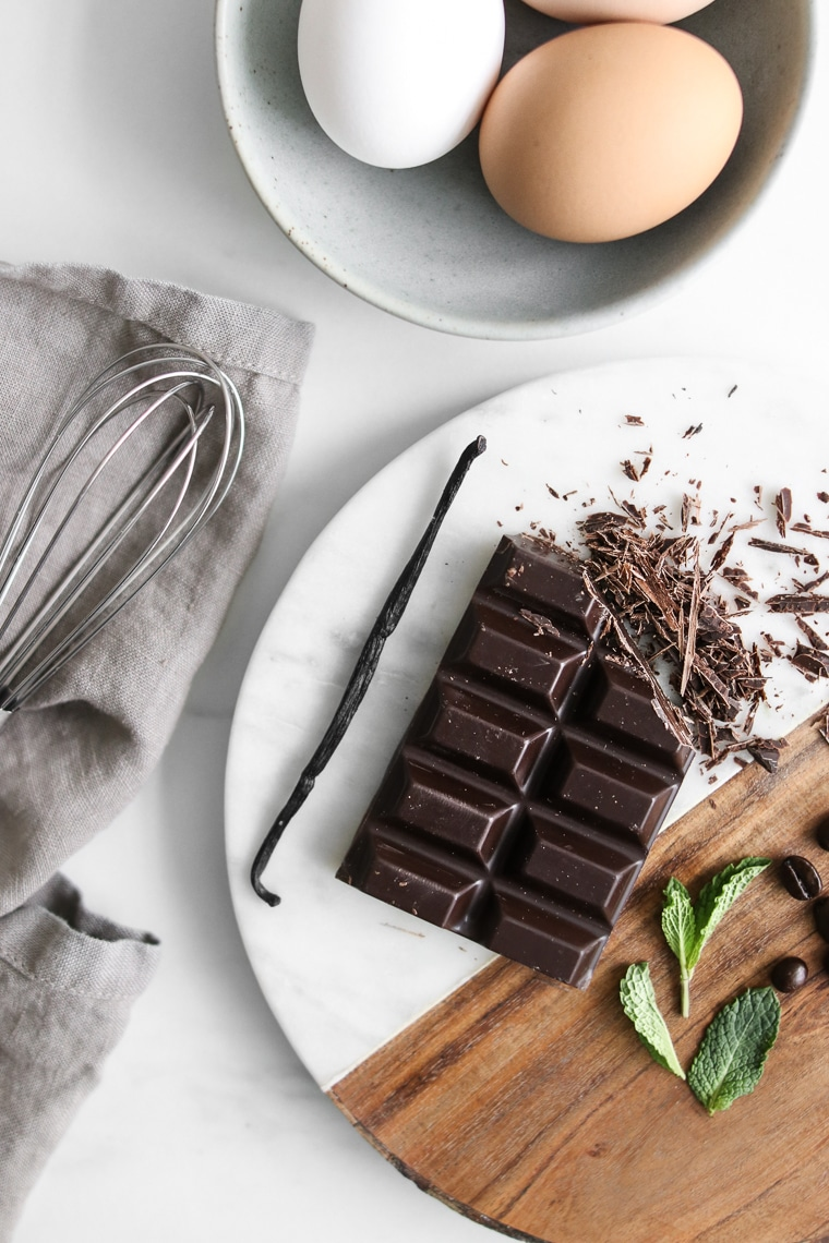 Mint leaves, chocolate squares, vanilla bean, coffee beans, and eggs