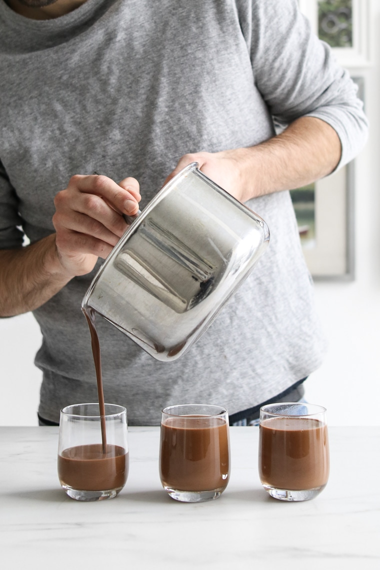 Philip pouring the chocolate coconut custard into the cups