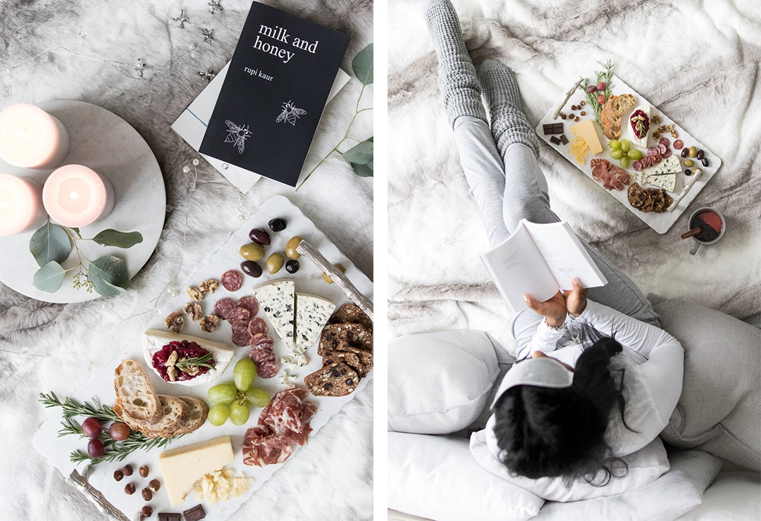 Two pictures: Left picture has comforting cheeseboard, candles and Milk and Honey Book. Right pictures has female reading a book next to the cheeseboard.