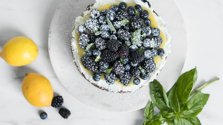 Overhead of cake topped with blackberries and blueberries