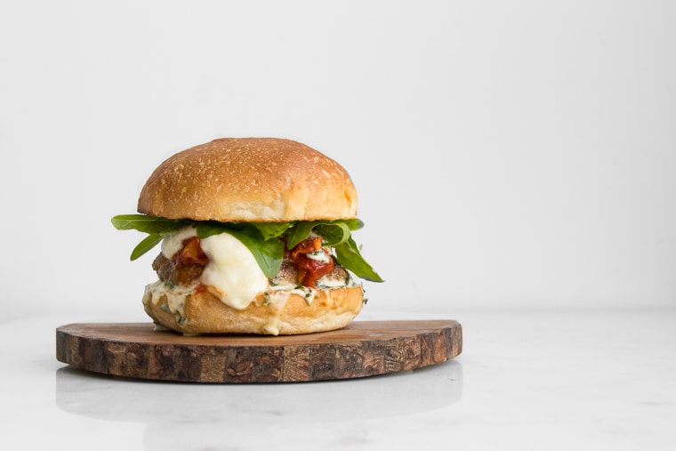 Pork Parmigiana Burger topped with Tomato Sauce and Mozzarella Cheese