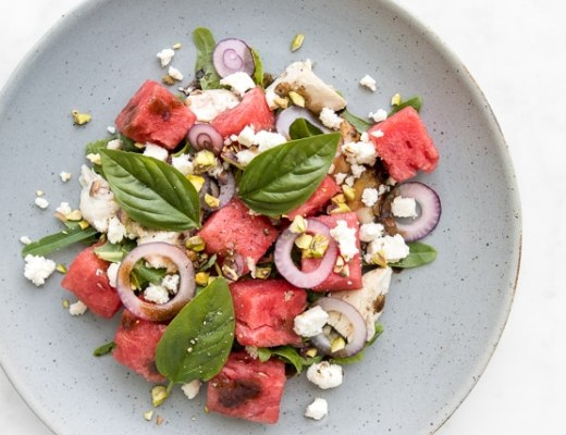 Close up of chicken, watermelon and feta salad on a blue plate