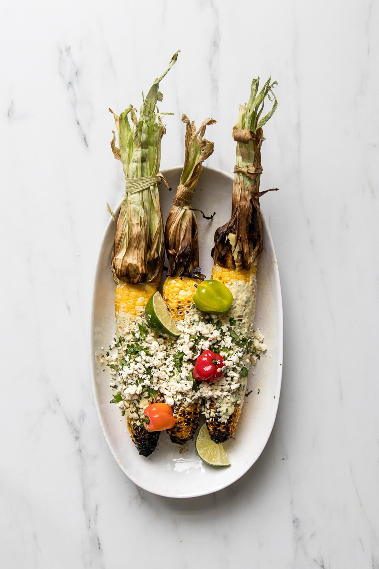 Plate with 3 grilled Caribbean street corn cobs