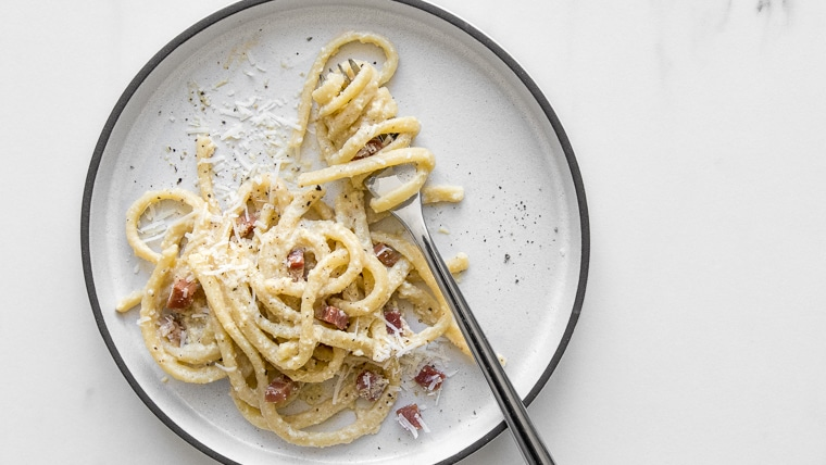 Plate of spaghetti carbonara with a fork
