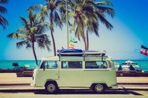 A van passing beside the beach road