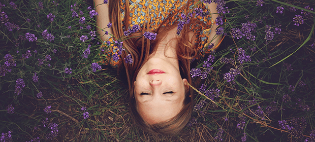 Woman relaxing in a field of lavendar