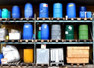 chemical containers stacked on shelving