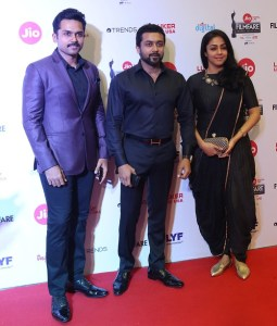 Actor Karthi with his brother Surya and his wife Jyothika