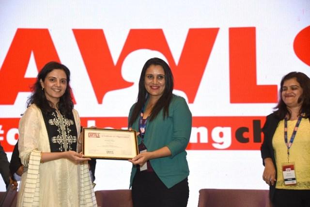 Priyanka Sehgal receiving the certificate