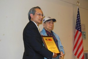 "Director-G​eneral Lai presents citation to WWII veteran William Seam Wong, U.S. Army, 14th Air Force (aka ""Flying Tigers""), 407th Air Service Squadron"