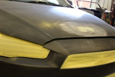 New bumper, headlights, grille and hood for Mitsubishi