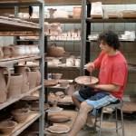 17. Joel-Cherrico-Pottery-at-The-Local-Blend-Brushing-Iron-onto-a-glazed-pot1
