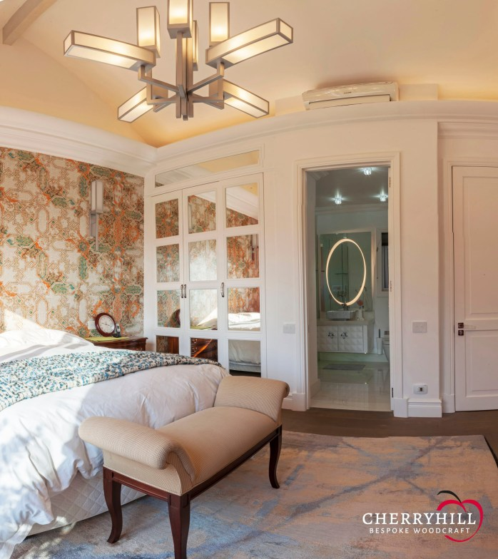 The guest bedroom in a private Sandhurst residence where Cherryhill made and installed the custom built-in cupboard and bathroom vanity.