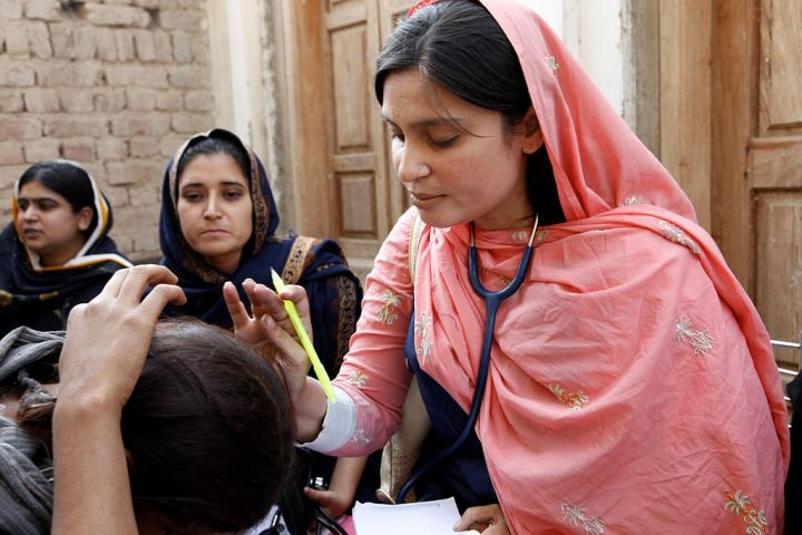 A female doctor in Pakistan examples a child, c. 2010. Courtesy of Department for International Development/Russell Watkins