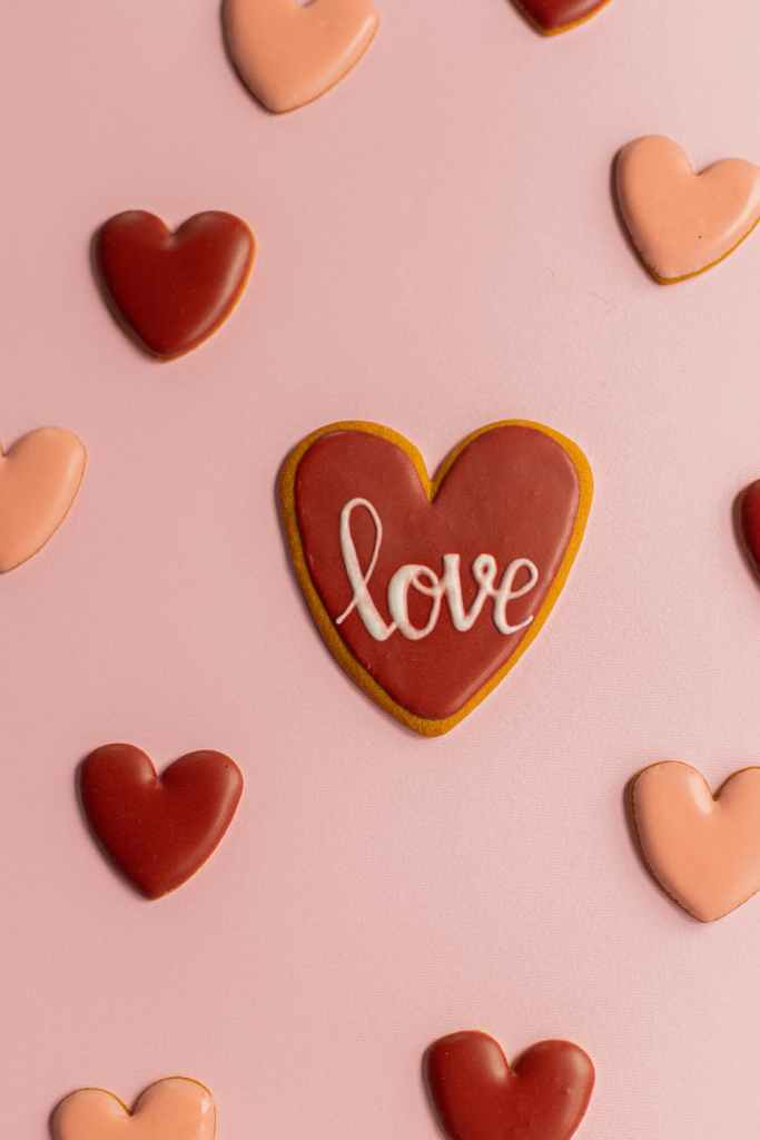 """Hearts with the word """"love"""" on them. We usually associate this with romantic love."""