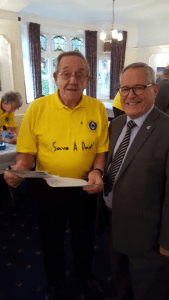 W Bro Adrian Davies with one of the volunteers for the PSA tests 2016