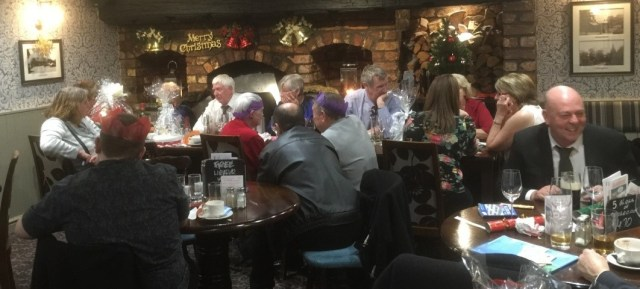 Members and guests enjoy a Christmas meal.