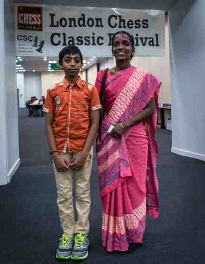 Grandmaster hopeful Praggu with his mother. Photo by LENNART OOTES
