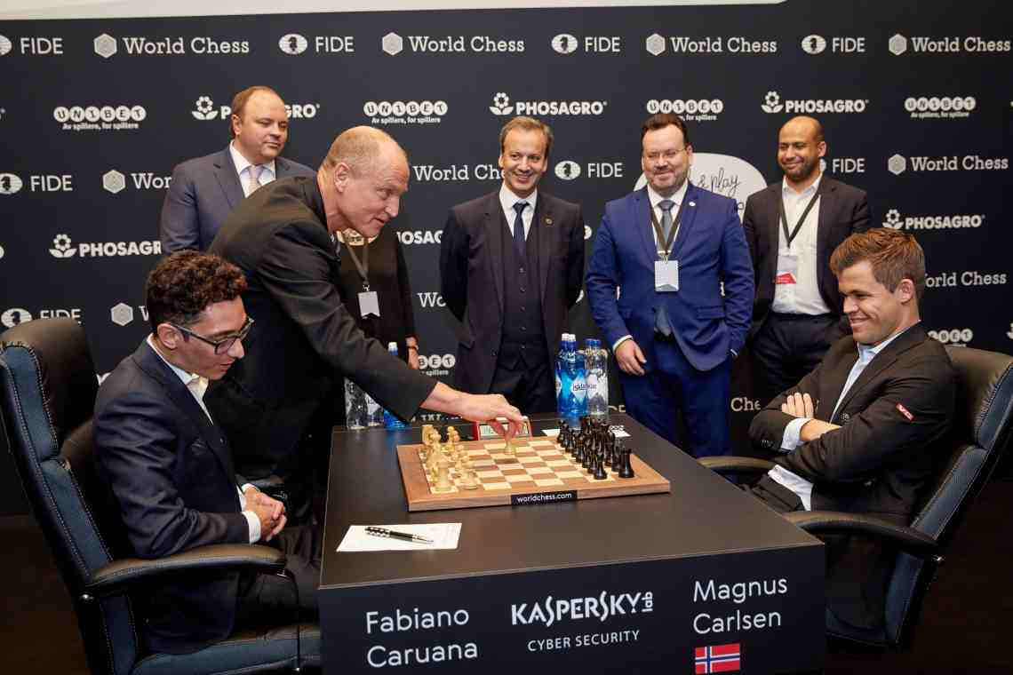 Andrey Guryev, Vice President and Member of the Board of Trustees of the Russian Chess Federation, CEO of PhosAgro, Woody Harrelson, Arkady Dvorkovich, President of FIDE, Stepahne Escafre, The Chief Arbiter of the Match, Ilya Merenzon, CEO of World Chess, Magnus Carlsen, the reigning World Chess Champion and Fabiano Caruana, US Challenger during the First Move Ceremony (Round 1) of the FIDE World Chess Championship Match 2018 on November 9, 2018 in London, England. (Photo by Tristan Fewings/Getty Images for World Chess ) *** Local Caption *** Andrey Guryev; Woody Harrelson; Arkady Dvorkovich; Stepahne Escafre; Ilya Merenzon; Magnus Carlsen; Fabiano Caruana