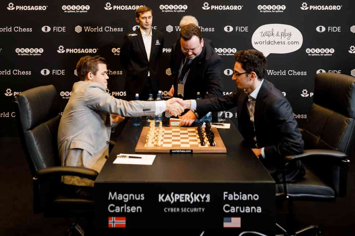 Magnus Carlsen and Fabiano Caruana shake hands to start Game 11