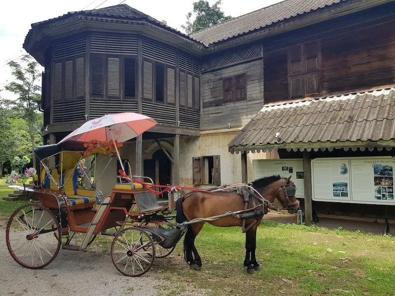 Horse cart in front of old house