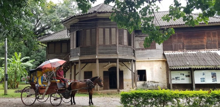 Horse cart in front of old house From Bangkok to Chiang Mai by train