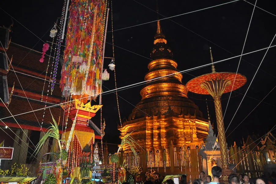 Chedi with colourful pillar after dark