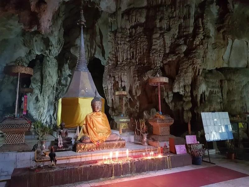 Buddha statue in cave
