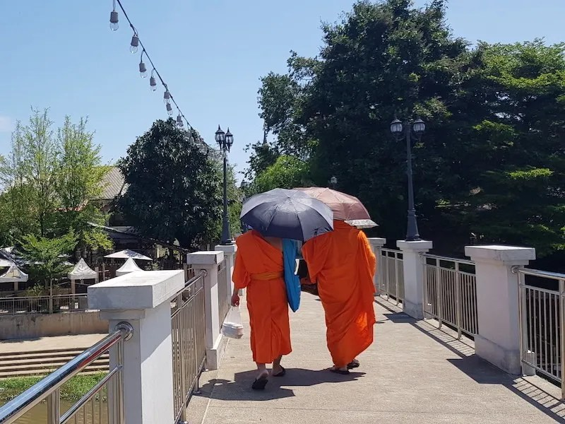 Buddhist monks on a bridge