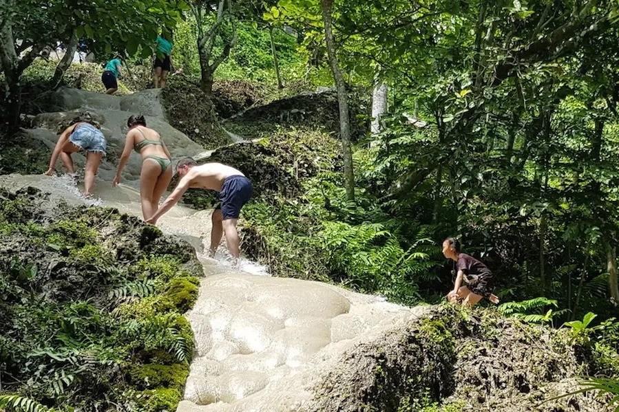 People climbing up a waterfall